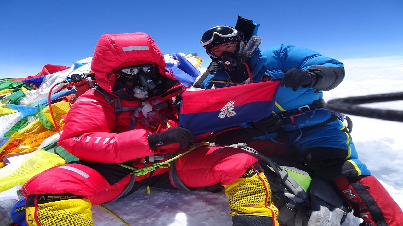 Smt. Aparna Kumar IPS ( UP Cadre ) at the Mount Everest peak holding UP Police colour